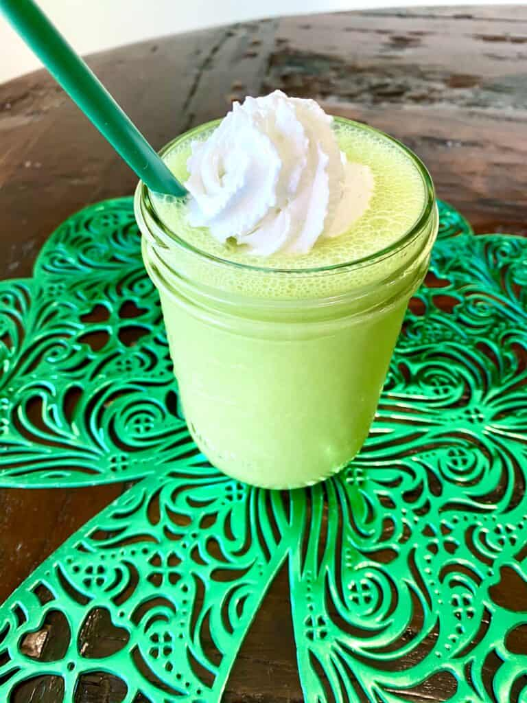 Healthy Vegan Shamrock Shake on a table with a green straw