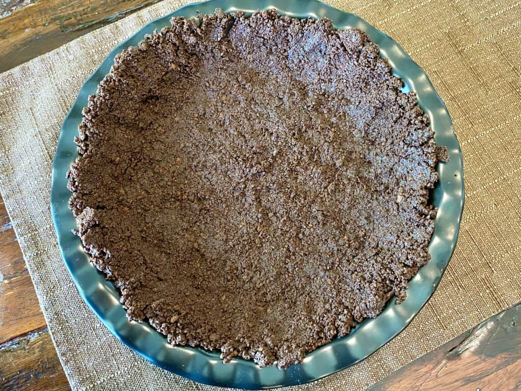 Thin Mint cookie crust pressed down in pan