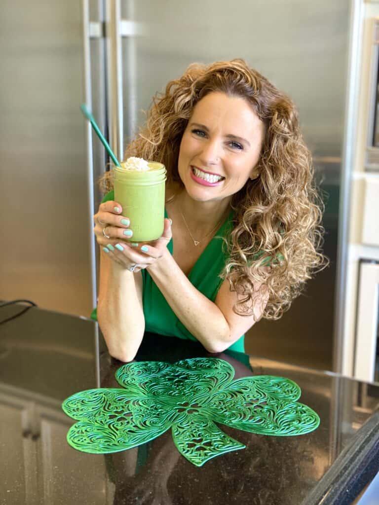 Audrey Dunham holding a Healthy Vegan Shamrock Shake