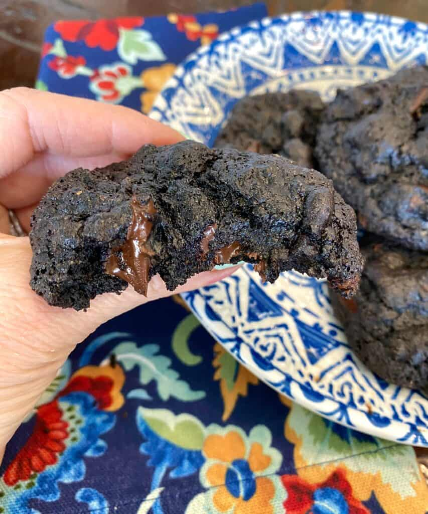 Midnight Nut Butter Chocolate Chunk Cookies with a bite taken out of it